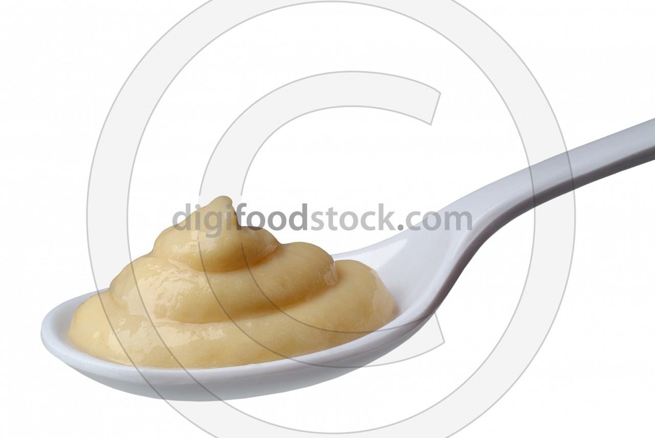 Spoon of fruit puree
