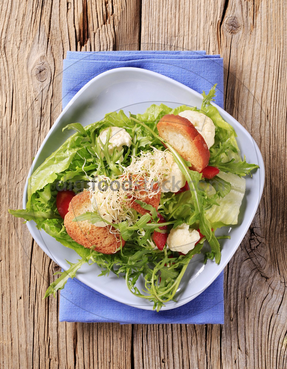 Healthy salad and crispy bread