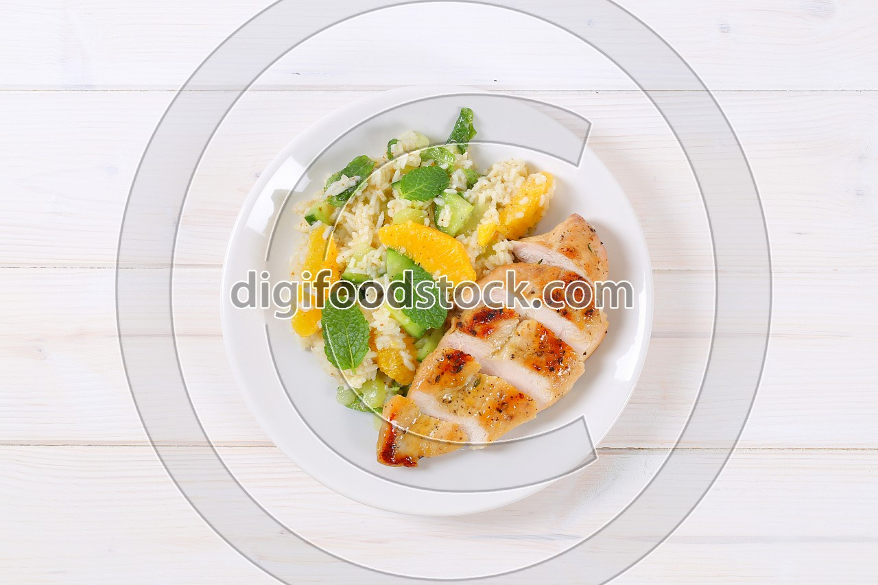 roasted chicken breast with rice and oranges